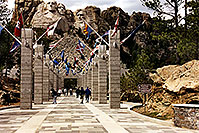/images/133/1999-04-sd-rushmore-flags-chris.jpg - #00324: Mt Rushmore … Christina moving Chicago-Phoenix … April 1999 -- Mt Rushmore, South Dakota