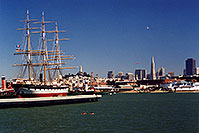 /images/133/2001-07-sfrisco-view1.jpg - 00859: Ship docked in San Francisco harbor … people swimming in the Bay … Seagull and Zeppelin in the air  … July 2001 -- San Francisco, California