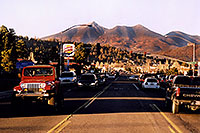 /images/133/2003-08-flagstaff-peaks1.jpg - 01277: the best view is from the middle of the road … red Jeep Wrangler leaving Flagstaff on I-17 to Phoenix  … August 2003 -- Humphreys Peak, Flagstaff, Arizona