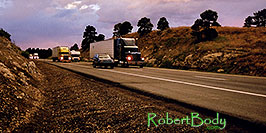 /images/133/2003-08-flagstaff-trucks-sunset-pano.jpg - #01293: outside of Flagstaff, heading to Santa Fe … August 2003 -- Flagstaff, Arizona