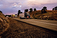 /images/133/2003-08-flagstaff-trucks-sunset.jpg - #01281: outside of Flagstaff, heading to Santa Fe … August 2003 -- Flagstaff, Arizona