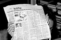 /images/133/2003-08-sonia1-bw.jpg - #01325: Sonia hiding behind a newspaper … August 2003 -- Santa Fe, New Mexico