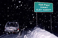 /images/133/2003-12-vail-pass-sign-jeep.jpg - #01421: Vail Pass Summit, Elevation 10,603ft … A snowy night at Vail Pass … Dec 2003 -- Vail, Colorado