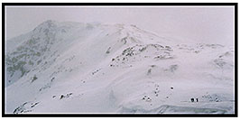 /images/133/2004-04-loveland-lost-pano.jpg - #01451: backcountry skiers heading uphill … frequent strong winds don