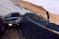 /images/133/2004-06-mtevans-holly06.jpg - #01554: Holly hiking along Mt Evans road … my Jeep next to 8ft tall snowbank … June 2004 -- Mount Evans Road, Mt Evans, Colorado