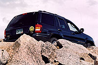 /images/133/2004-06-mtevans-jeep-above.jpg - 01556: Jeep at 12,000 ft … along Mt Evans road … June 2004 -- Mount Evans Road, Mt Evans, Colorado