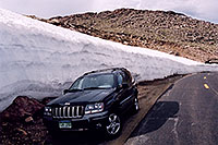 /images/133/2004-06-mtevans-jeep-drift.jpg - 01557: my Jeep next to 8ft tall snowbank at 13,000 ft … along Mt Evans road … June 2004 -- Mount Evans Road, Mt Evans, Colorado