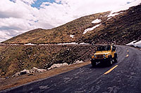 /images/133/2004-06-mtevans-road-cars1.jpg - #01579: yellow Jeep Wrangler driving down from Mt Evans … June 2004 -- Mount Evans Road, Mt Evans, Colorado