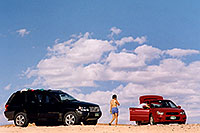 /images/133/2004-07-powell-ewka-car.jpg - #01755: Ewka walking to Aneta and her red Subaru at Lone Rock … July 2004 -- Lone Rock, Lake Powell, Utah