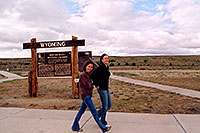/images/133/2004-08-wyo-casper-girls.jpg - #02001: Ola and Ewka walking in Wyoming wind … skies clearing up as we near Yellowstone … August 2004 -- Casper, Wyoming
