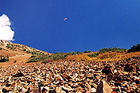 /images/133/2004-10-cinnamon-para-oran2.jpg - #02255: Orange Paraglider over Cinnamon Mountain (12,293ft) … Oct 2004 -- Paradise Divide, Crested Butte, Colorado