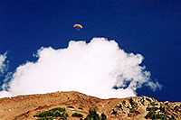 /images/133/2004-10-cinnamon-para-oran4.jpg - #02257: Orange Paraglider over Cinnamon Mountain (12,293ft) … Oct 2004 -- Paradise Divide, Crested Butte, Colorado