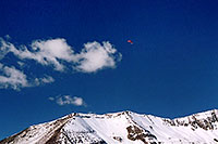 /images/133/2004-10-cinnamon-para-red3.jpg - #02260: Red Paraglider west of Cinnamon Mountain (12,293ft)… Oct 2004 -- Paradise Divide, Crested Butte, Colorado