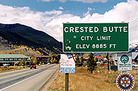 /images/133/2004-10-crested-sign2.jpg - #02306: red Jeep Wrangler heading to Gunnison from Crested Butte … Oct 2004 -- Crested Butte, Colorado