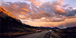 /images/133/2004-10-crested-suns-hors2-w.jpg - #02309: red Jeep Grand Cherokee and horse walking home during evening on Slate River Road … Oct 2004 -- Crested Butte, Colorado