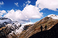 /images/133/2004-10-crested-yule-ridge1.jpg - #02335: skier and snowboarder on trail from Paradise Divide to Yule Pass … October 2004 -- Paradise Divide, Crested Butte, Colorado