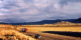 /images/133/2004-10-yaks-landscape-pano.jpg - #02369: red semi truck heading to Gunnison in the late October afternoon … Yaks to the right  … October 2004 -- Sargeants, Colorado