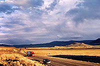 /images/133/2004-10-yaks-landscape.jpg - #02352: red semi truck heading to Gunnison in the late October afternoon … Yaks to the right  … October 2004 -- Sargeants, Colorado