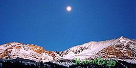 /images/133/2005-01-fremont-pass-sunset-pano.jpg - #02412: Moon over Fremont Pass, looking from Leadville side  … Dec 2004 -- Fremont Pass, Colorado