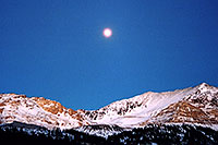 /images/133/2005-01-fremont-pass-sunset.jpg - #02411: Moon over Fremont Pass, looking from Leadville side  … Dec 2004 -- Fremont Pass, Colorado