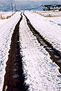 /images/133/2005-03-delnorte-snow-road-v.jpg - #02443: road heading towards the mountains … along Spanish Trail … March 2005 -- Del Norte, Colorado