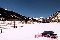 /images/133/2005-03-silverton-stuck-car.jpg - #02549: parked last Fall in Silverton … March 2005 -- Silverton, Colorado