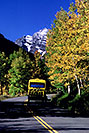 /images/133/2005-09-maroon-road2-v.jpg - #02634: yellow Blazing Adventures tour bus on a road to Maroon Bells … images of Maroon Bells … Sept 2005 -- Maroon Bells, Colorado