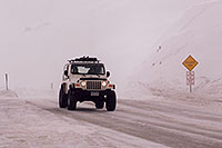 /images/133/2006-02-loveland-jeep2.jpg - #02759: white Jeep Wranger in snowstorm at top of Loveland Pass … Feb 2006 -- Loveland Pass, Colorado