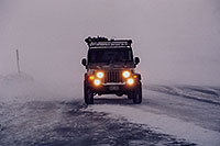 /images/133/2006-02-loveland-jeep3.jpg - 02760: grey Jeep Wrangler in snowstorm at top of Loveland Pass … Feb 2006 -- Loveland Pass, Colorado