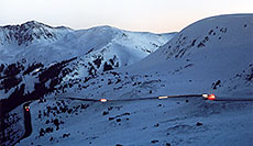 /images/133/2006-02-loveland-night1.jpg - #02761: cars moving along the road up to Loveland Pass from Keystone side … Feb 2006 -- Loveland Pass, Colorado