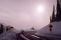 /images/133/2006-02-loveland-road-sun.jpg - #02769: car driving up to Loveland Pass from Keystone side … Feb 2006 -- Loveland Pass, Colorado