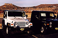 /images/133/2006-03-castlerock-jeeps1.jpg - #02799: white and black Jeep Wrangler Rubicons in Castle Rock … March 2006 -- Castle Rock, Colorado