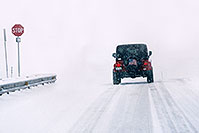 /images/133/2006-03-i70-red-jeep1.jpg - #02813: Red Jeep Wrangler entering the blizzard … March 2006 -- I-70, Golden, Colorado