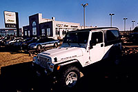 /images/133/2006-03-lithia-jeep-sign1.jpg - #02831: white 2006 Jeep Wrangler Rubicon Unlimited at Lithia Jeep in Centennial … March 2006 -- Lithia Jeep, Centennial, Colorado