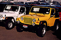 /images/133/2006-03-lithia-wranglers2.jpg - #02842: white 2006 Jeep Wrangler X and yellow Wrangler Sport at Lithia Jeep … March 2006 -- Lithia Jeep, Centennial, Colorado