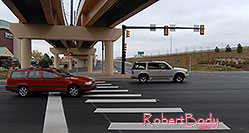 /images/133/2006-10-08-cent-road01.jpg - #02965: red Volvo at I-25 and Dry Creek in Centennial … Oct 2006 -- Centennial, Colorado