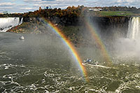 /images/133/2006-10-15-niag-rainbow01.jpg - #03029: boat within double rainbow heading from Canadian Falls (right) to US Falls (left) … Oct 2006 -- Niagara Falls, Ontario.Canada