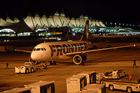 /images/133/2006-10-22-den-frontier01.jpg - #03113: Detroit bound Frontier plane preparing to leave Denver airport … Oct 2006 -- Denver, Colorado