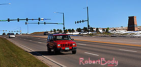 /images/133/2006-10-28-lone-lincoln01.jpg - #03136: red Jeep Cherokee on Lincoln Road … Oct 2006 -- Lincoln Rd, Lone Tree, Colorado