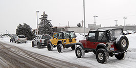 /images/133/2007-01-12-lithia-jeeps05.jpg - #03345: red and yellow Jeep Wranglers at Lithia Jeep … Jan 2007 -- Lithia Jeep, Englewood, Colorado