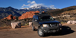 /images/133/2007-02-26-gods-xterra-w.jpg - #03537: Xterra with Garden of the Gods and Pikes Peak in the background … Feb 2007 -- Garden of the Gods, Colorado Springs, Colorado