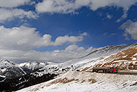 /images/133/2007-04-01-loveland-road02.jpg - #03652: red semi truck approaching top of Loveland Pass from Denver side … April 2007 -- Loveland Pass, Colorado