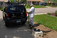 /images/133/2007-05-20-lake-bee-keeper2.jpg - #03795: Beekeeper Phil moving bees to a new home - A swarm of 2,500 bees with a queen moved into the back of my Xterra … May 2007 -- Lakewood, Colorado