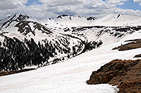/images/133/2007-05-28-indep-mtns02.jpg - #03816: snowboarder walking at Independence Pass … view of Independence Mountain at 12,703 ft … May 2007 -- Independence Mountain, Independence Pass, Colorado