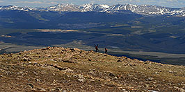 /images/133/2007-06-10-elbert-skier1-pano.jpg - #03898: Skier and hiker with dogs  walking up the North Trail of Mt Elbert, Colorado