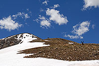 /images/133/2007-06-10-elbert-skier7.jpg - #03903: Skier resting along the North Trail of Mt Elbert, Colorado