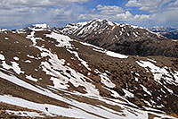 /images/133/2007-06-10-elbert-skier9.jpg - #03905: Skier walking across a snowfield on Mt Elbert … view of Mt Massive at 14,421 ft … June 2007 -- Mt Elbert, Colorado