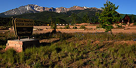 /images/133/2007-06-22-pikes-hut02-pano.jpg - #03982: Crystal Reservoir Visitor Center with Pikes Peak in the background … June 2007 -- Pikes Peak, Colorado