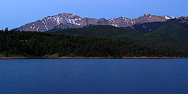 /images/133/2007-06-22-pikes-presun01-pano.jpg - #03992: Pikes Peak at sunrise … a light beacon on the summit … June 2007 -- Crystal Reservoir, Pikes Peak, Colorado