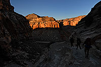 /images/133/2008-04-04-hav-eric-9528.jpg - #05057: Hikers along the first mile of switchbacks of Havasupai Trail at 8 am … April 2008 -- Havasupai Trail, Havasu Falls, Arizona